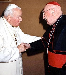 Pope John Paul II shaking hands with U.S. Cardinal John O'Connor. Note the position of the thumb.