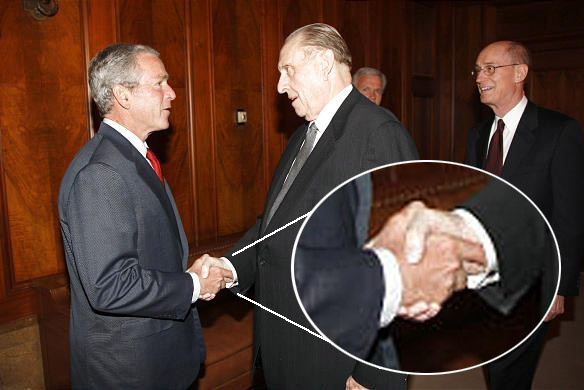 President Thomas S. Monson shaking hands with President George W. Bush. Notice the location of the index fingers.